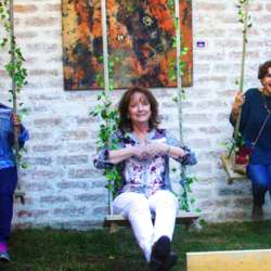 Charlett, Carole and Su celebrating our one year anniversary of InterNations in Cuenca on the swings at The Garden.